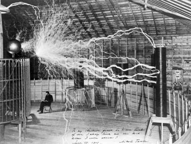 nikola_tesla_with_his_equipment_wellcome_m0014782